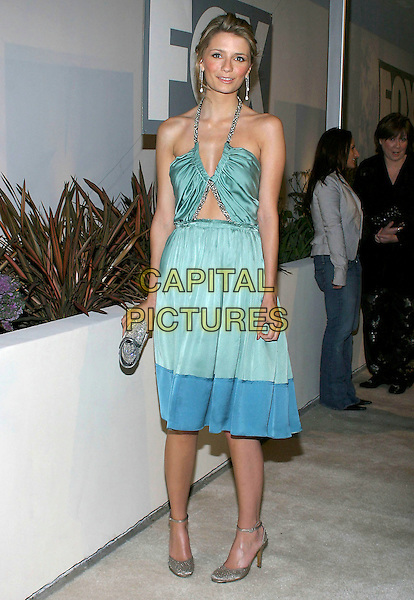 "MISCHA BARTON.Fox TV ""White Hot Winter"" Network Party at Meson G Restaurant, Los Angeles, California, USA, .17th January 2005..full length blue green cut out halterneck dress clutch bag purse skinny thin.Ref: ADM.www.capitalpictures.com.sales@capitalpictures.com.©Jacqui Wong/AdMedia/Capital Pictures .."