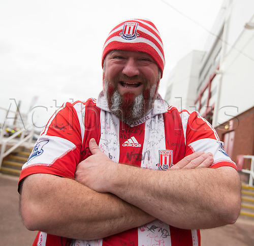 05.12.2015. Britannia Stadium, Stoke, England. Barclays Premier League. Stoke City versus Manchester City. A Stoke City football supporter with his beard painted in the team colours outside the Britannia Stadium, home of Stoke City FC.