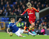 23rd  November 2019; Goodison Park , Liverpool, Merseyside, England; English Premier League Football, Everton versus Norwich City; Lucas Digne of Everton slides in to tackle Todd Cantwell of Norwich City - Strictly Editorial Use Only. No use with unauthorized audio, video, data, fixture lists, club/league logos or 'live' services. Online in-match use limited to 120 images, no video emulation. No use in betting, games or single club/league/player publications