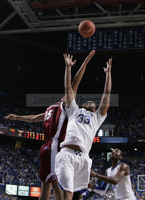 University of Kentucky freshman forward Daniel Orton jumps for a rebound against Rider forward Jermaine Jackson during the first half of UK's 93-63 win on Nov., 21, 2009 at Rupp Arena...Photo by Ed Matthews | Staff