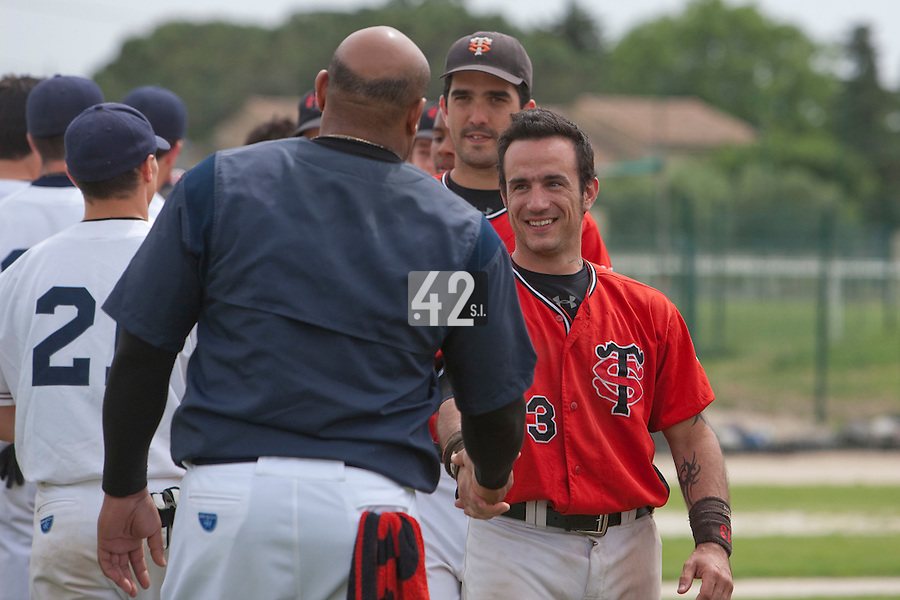 21 May 2009: Frederic Rouge of Toulouse smiles to Carlos Jiminian of Savigny during the 2009 challenge de France, a tournament with the best French baseball teams - all eight elite league clubs - to determine a spot in the European Cup next year, at Montpellier, France.