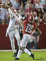 NWA Democrat-Gazette/JASON IVESTER <br /> Arkansas quarterback Brandon Allen (10) attempts a pass over Alabama defensive back Ronnie Harrison (15) during the second quarter on Saturday, Oct. 10, 2015, at Bryant-Denny Stadium in Tuscaloosa, Ala.