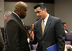 Assembly Majority Leader William Horne, D-Las Vegas, left, and Nevada Gov. Brian Sandoval talk in committee at the Legislative Building in Carson City, Nev., on Thursday, Feb. 21, 2013.   .Photo by Cathleen Allison