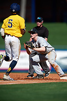 Army West Point second baseman Josh White (3) waits for a throw as Christan Bullock (5) runs up the baseline with umpire Mark Spicer looking on during a game against the Michigan Wolverines on February 17, 2018 at First Data Field in St. Lucie, Florida.  Army defeated Michigan 4-3.  (Mike Janes/Four Seam Images)