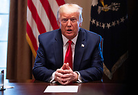 United States President Donald J. Trump speaks to reporters as he holds a meeting with nurses on the COVID-19 response at the White House in Washington, DC, March 18, 2020, in Washington, D.C. <br /> Credit: Kevin Dietsch / Pool via CNP/AdMedia