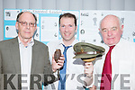 Stephen Thompson, Conor Doolin and Noel Grimes with a hand grenade and a hat from the 1916  Rising memorabilia Centenary exhibition in the Malton Hotel on Tuesday evening