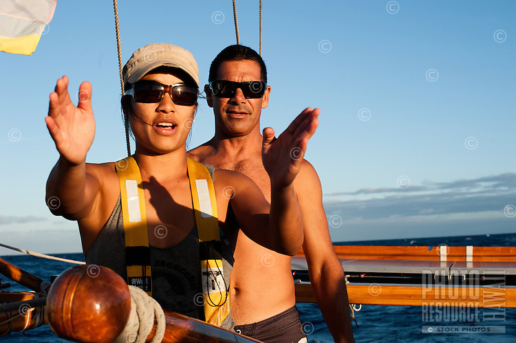 Crew members, Tricia Dang (left) and Kamaki Worthington (right) aboard Polynesian voyaging canoe, Hokule'a; training sail for Worldwide Voyage 2013 _ Augtust 9, 2012 _ Honolulu, Hawaii