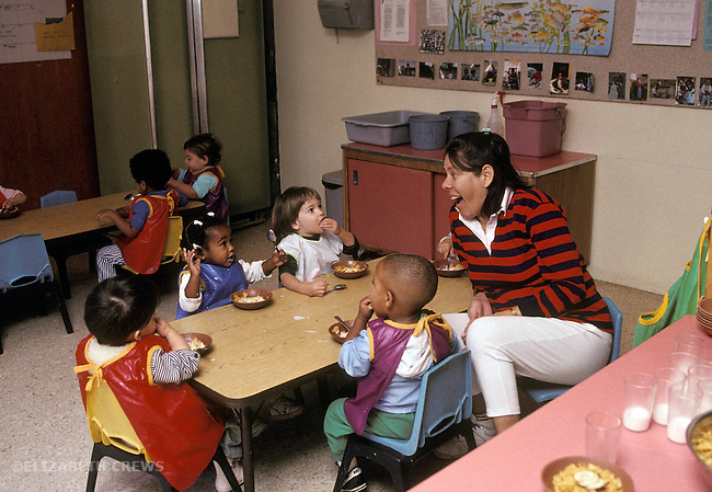 Berkeley CA Children seventeen months-old to age two, having morning snack at day care
