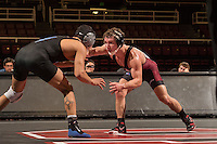STANFORD, CA - January 18, 2015: Evan Silver of the Stanford Cardinal wrestling team competes during a meet against Air Force Falcons at Maples Pavilion. Stanford won 27-8.