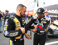 Feb 26, 2017; Chandler, AZ, USA; NHRA top fuel driver Tony Schumacher (left) and teammate Antron Brown during the Arizona Nationals at Wild Horse Pass Motorsports Park. Mandatory Credit: Mark J. Rebilas-USA TODAY Sports