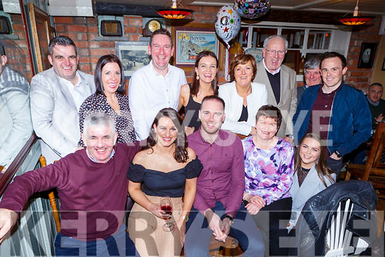 Louise Moynihan Ross Road and Barry Murphy Casragh Lake celebrate their engagement and Denis Moynihan seated left celebrated his 60th birthday in the Porterhouse restaurant Killarney on Saturday night