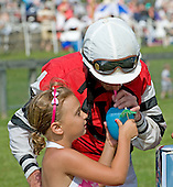Richard Boucher gets a well-deserved drink from his daughter after Class Classic's win in the 7th at Fair Hill.