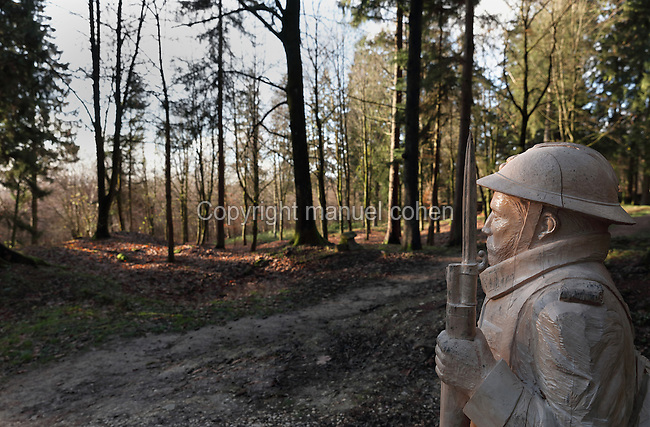 Sculpture of a French poilu or soldier, carved from a tree trunk, at the site of a crater where the remains of 26 French soldiers were discovered in 2013. The crater was originally a building in the village of Fleury-devant-Douaumont, Verdun, Meuse, Lorraine, France, which was completely destroyed in the Battle of Verdun in World War One. Prior to the war the village had 400 inhabitants but found itself on the front line, was destroyed and never rebuilt. Picture by Manuel Cohen