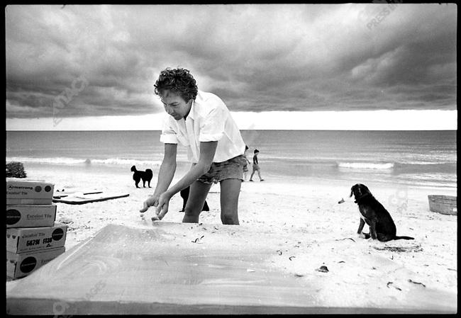 Robert Rauschenberg, artist, on the beach near his beach home in Captiva Island, FL, 1973