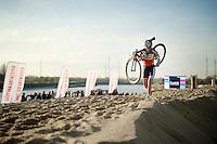 Sanne Cant (BEL/BKCP-Powerplus) running towards victory solo <br /> <br /> Jaarmarktcross Niel 2014