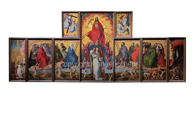 Open panels of the polyptych altarpiece, 1446-52, with Christ the Supreme Judge on Judgement Day above Michael the archangel weighing the souls, flanked by the Virgin and John the Baptist and apostles and saints, with the blessed going to heaven and the damned going to hell below, by Rogier van der Weyden, 1399-1464, commissioned by Nicolas Rolin in 1443, in Les Hospices de Beaune, or Hotel-Dieu de Beaune, a charitable almshouse and hospital for the poor, built 1443-57 by Flemish architect Jacques Wiscrer, and founded by Nicolas Rolin, chancellor of Burgundy, and his wife Guigone de Salins, in Beaune, Cote d'Or, Burgundy, France. The altarpiece was originally in the Chapel, but is now in the museum. The panels were only opened to patients during holy days. The hospital was run by the nuns of the order of Les Soeurs Hospitalieres de Beaune, and remained a hospital until the 1970s. The building now houses the Musee de l'Histoire de la Medecine, or Museum of the History of Medicine, and is listed as a historic monument. Picture by Manuel Cohen