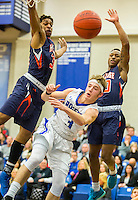 NWA Democrat-Gazette/JASON IVESTER<br /> Jake Benninghoff, Rogers High junior, sends a pass to a teammate on Tuesday, Jan. 12, 2016, during their game against Rogers Heritage at Rogers High.