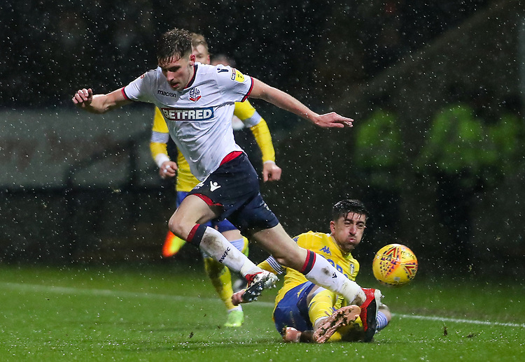 Bolton Wanderers' Joe Williams competing with Leeds United's Pablo Hernandez<br /> <br /> Photographer Andrew Kearns/CameraSport<br /> <br /> The EFL Sky Bet Championship - Bolton Wanderers v Leeds United - Saturday 15th December 2018 - University of Bolton Stadium - Bolton<br /> <br /> World Copyright © 2018 CameraSport. All rights reserved. 43 Linden Ave. Countesthorpe. Leicester. England. LE8 5PG - Tel: +44 (0) 116 277 4147 - admin@camerasport.com - www.camerasport.com