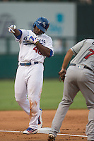 Oklahoma City Dodgers Yasiel Puig (46) points to the dugout after hitting a triple during the game against the El Paso Chihuahuas at Chickasaw Bricktown Ballpark on August 12, 2016 in Oklahoma City, Oklahoma. Oklahoma City defeated El Paso 8-4.  (William Purnell/Four Seam Images)