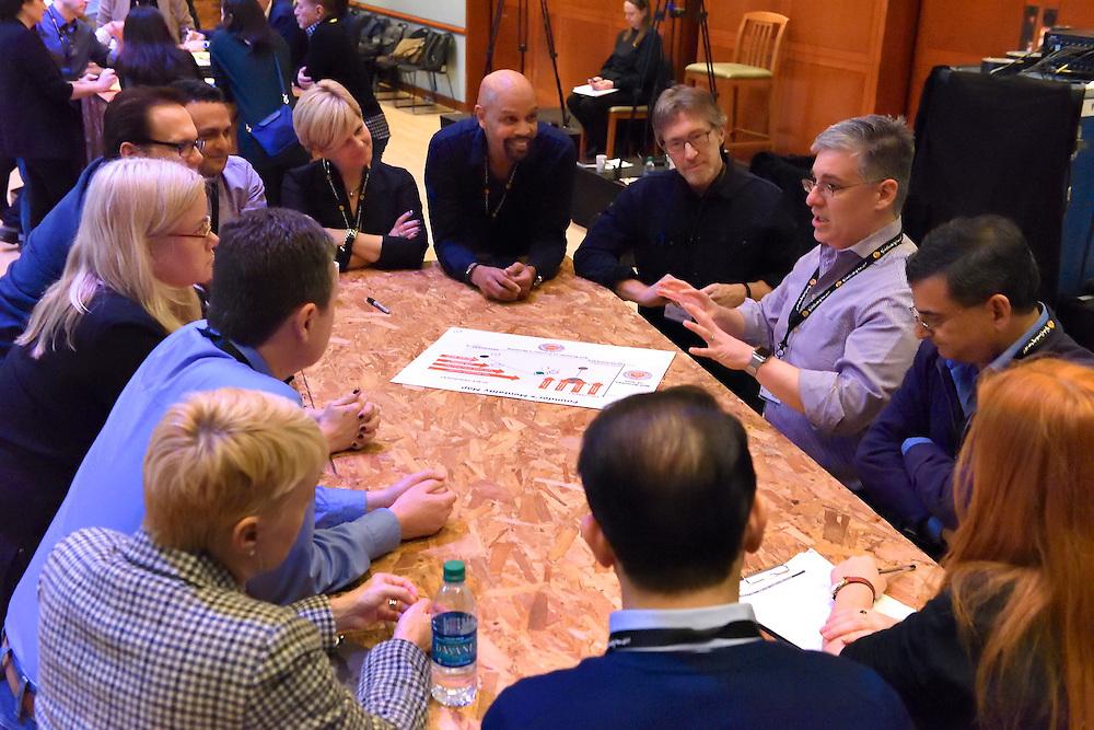 Working in teams at a leadership forum.