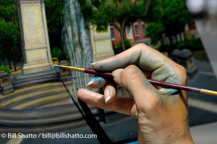 Artist's hand at work.