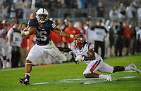 19 September 2015:  Penn State RB Saquon Barkley stiff-arms Rutgers S Davon Jacobs (29) during a long run. Barkley rushed for 195 yards and 2 touchdowns. The Penn State Nittany Lions defeated the Rutgers Scarlett Knights 28-3 at Beaver Stadium in State College, PA.