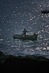 Man fishing from rowing boat, Los Abrigos, Tenerife, Canary Islands.