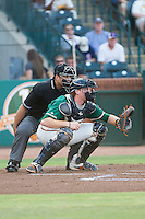 Greensboro Grasshoppers catcher Chad Wallach (47) sets a  target as home plate umpire Zach Tieche looks over his shoulder during the game against the Hagerstown Suns at NewBridge Bank Park on June 21, 2014 in Greensboro, North Carolina.  The Grasshoppers defeated the Suns 8-4. (Brian Westerholt/Four Seam Images)