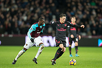 Mesut Ozil of Arsenal holds off Pedro Obiang of West Ham United during the Premier League match between West Ham United and Arsenal at the Olympic Park, London, England on 13 December 2017. Photo by Andy Rowland.