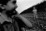 Junior and Rachel Miller play while corn is harvested on the family farm, Kalona, 2005