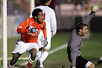 Clemson's Dane Richards (10) reacts to his 40th minute goal as New Mexico goalkeeper Mike Graczyk (right) appeals to the referee for an infraction.  The goal was allowed, and tied the game 1-1. The University of New Mexico defeated Clemson University 2-1 in the NCAA Semifinal at SAS Stadium in Cary, North Carolina, Friday, December 9, 2005.