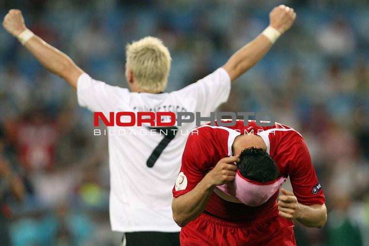 UEFA Euro 2008 Semi-Finals Match 29 Basel - St. Jakob-Park. Deutschland ( GER ) - T&uuml;rkei ( TUR ) 3:2 ( 1:1 ). <br /> Bastian Schweinsteiger ( Germany / Mittelfeldspieler / Midfielder / Bayern Muenchen #07 ) (l) feiert den Sieg gegen die T&uuml;rkei und den Einzug ins Finale. Hakan Balta ( T&uuml;rkei / Verteidiger / Defender / Galatasaray Istanbul #03 ) (r) ist entt&auml;uscht und zieht sich das Trikot &uuml;ber den Kopf.<br /> Foto &copy; nph (  nordphoto  )