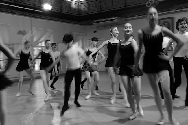 Girls and boys from the fourth and fifth year classes at the Vaganova Ballet Academy in St. Petersburg exited the stage in a first rehearsal for a stage performance, part of the academy's training to prepare students, even young students, for the real stage. March 18, 2009