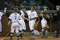 Theodore Hoffman (16) of the High Point-Thomasville HiToms celebrates with teammates after hitting a home run against the Asheboro Copperheads at Finch Field on June 12, 2015 in Thomasville, North Carolina.  The HiToms defeated the Copperheads 12-3. (Brian Westerholt/Four Seam Images)
