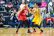 Washington, DC - July 22, 2016: Washington Mystics guard Natasha Cloud (15) defends Los Angeles Sparks guard Kristi Toliver (20) during their match up at the Verizon Center in Washington, DC. (Photo by Phil Peters/Media Images International)