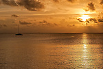 A lone yacht at sunset in the lagoon in Tuvalu
