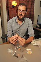 NWA Democrat-Gazette/MICHAEL WOODS • @NWAMICHAELW<br /> University of Arkansas biological anthropologist Lucas Delezene shows some of the teeth molds he is studying Thursday September 10, 2015 at his office in Old Main. Delezene is part of the international team of scientists who verified that fossils found in a South African cave belong to a new species of human ancestor.