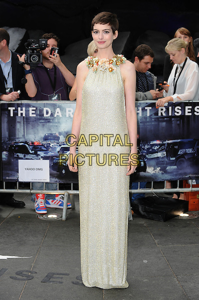 Anne Hathaway (wearing Gucci).'The Dark Knight Rises' European Premiere at The Odeon and Empire cinema, Leicester Square, London, England..18th July 2012.full length embellished jewel encrusted flowers floral pearls collar short cropped hair sleeveless silver gold cream beige dress  .CAP/BEL.©Tom Belcher/Capital Pictures.
