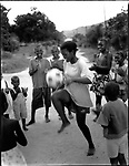 "Thembisa ""Portia"" Mtokwana (23), with local kids, Gunguletu Township, Cape Town, South Africa, 1998"