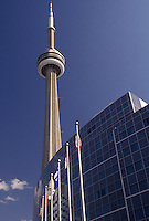 AJ3071, Toronto, Ontario, Canada, Flags fly in front of the Skydome Hotel and CN Tower in downtown Toronto.