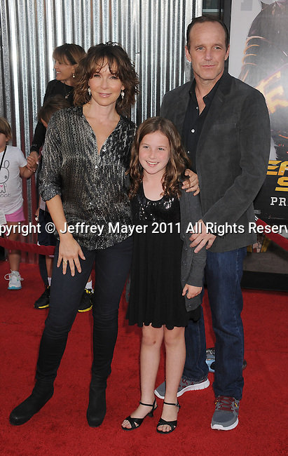"UNIVERSAL CITY, CA - OCTOBER 02: Jennifer Grey, Clark Gregg and Stella Gregg attend the ""Real Steel"" Los Angeles Premiere at Gibson Amphitheatre on October 2, 2011 in Universal City, California."