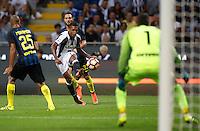 Calcio, Serie A: Inter vs Juventus. Milano, stadio San Siro, 18 settembre 2016.<br /> Juventus&rsquo; Alex Sandro, center, kicks the ball during the Italian Serie A football match between FC Inter and Juventus at Milan's San Siro stadium, 18 September 2016.<br /> UPDATE IMAGES PRESS/Isabella Bonotto