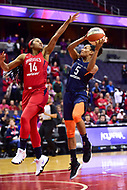 Washington, DC - June 3, 2018: Connecticut Sun guard Jasmine Thomas (5) goes up for a layup over Washington Mystics guard Tierra Ruffin-Pratt (14) during game between the Washington Mystics and Connecticut Sun at the Capital One Arena in Washington, DC. (Photo by Phil Peters/Media Images International)