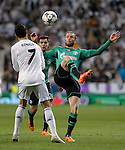 Real Madrid's Portuguese forward Cristiano Ronaldo vies with Schalke's Tim Hoogland during the UEFA Champions League football match Real Madrid CF vs Schalke 04 FC at the Santiago Bernabeu stadium in Madrid on March 18, 2014.  PHOTOCALL3000/ DP