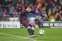 Michael McGovern of Northern Ireland kicks from goal during the International Friendly match between Wales and Northern Ireland at Cardiff City Stadium, Cardiff, Wales on 24 March 2016. Photo by Mark  Hawkins / PRiME Media Images.