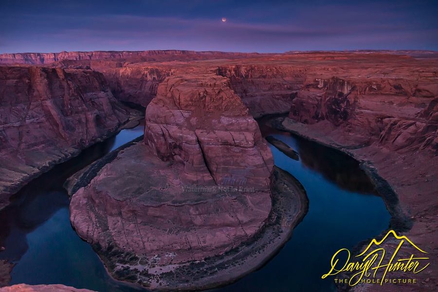 Blue Moon Eclipse, Horseshoe Bend, Page Arizona. Once in a blue moon is a metaphor for rare events.  Blue moons aren't really blue, they are merely a second blue moon of a calendar month. As we know moon eclipses are even rarer than blue moons, here we have an eclipsing blue moon. <br />
