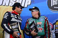 Sept. 14, 2012; Concord, NC, USA: NHRA funny car driver Cruz Pedregon (left) with John Force during qualifying for the O'Reilly Auto Parts Nationals at zMax Dragway. Mandatory Credit: Mark J. Rebilas-