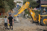 Pictured: A digger assists with the preliminary search at the new site in Kos, Greece. Friday 07 October 2016<br />
