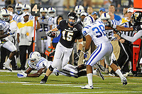 1 October 2011:  FIU tight end Colt Anderson (15) attempts to evade Duke safety Jordon Byas (38) and safety Walt Canty (4) while picking up a first down in the third quarter as the Duke University Blue Devils defeated the FIU Golden Panthers, 31-27, at FIU Stadium in Miami, Florida.
