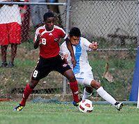 Christian Jimenez (6) of Guatemala fights for the ball with Karl Muckette (8) of Trinidad & Tobago  during the group stage of the CONCACAF Men's Under 17 Championship at Jarrett Park in Montego Bay, Jamaica. Trinidad & Tobago defeated Guatemala, 1-0.